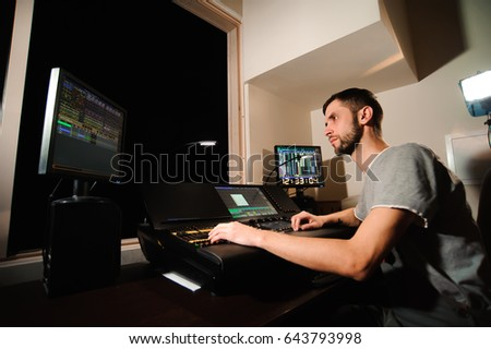 A lighting engineer works with lights technicians control on the concert show. Professional light mixer & Lighting Engineer Works Lights Technicians Control Stock Photo ... azcodes.com