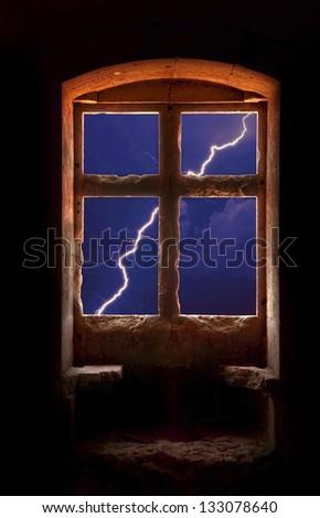 A lightning bolt seen thru a window. - stock photo