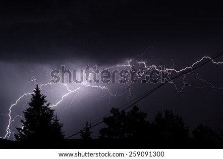 A lightning flash during a thunderstorm - stock photo