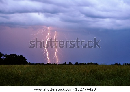 A lightning from an approaching storm.  - stock photo