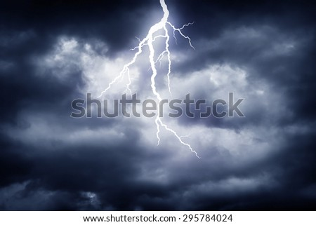 A lightning strike on the cloudy sky - stock photo