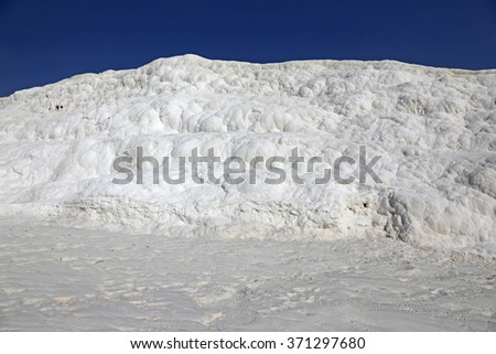 """A limestone wall at Pamukkale, which means """"cotton castle"""" in Turkish.  It is natural site in southwest Turkey. - stock photo"""