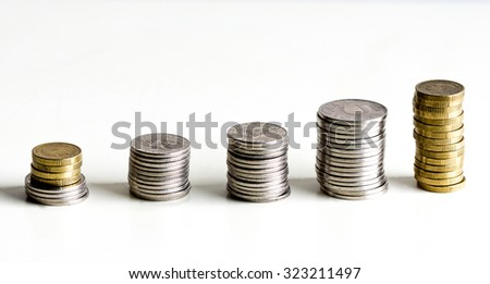 a line of coins in stack