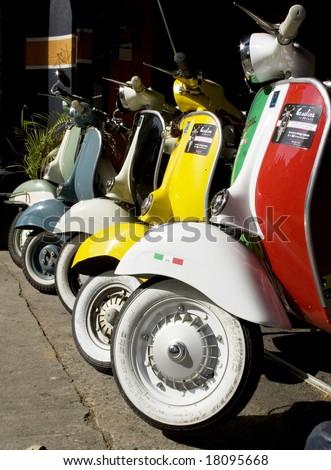 a line of Italian vespas - stock photo