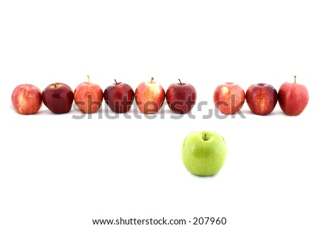 A line of red apples with one green apple - stock photo