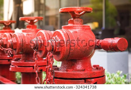 A line of red fire hydrant  - stock photo