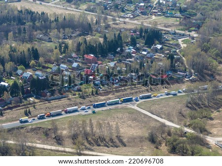 A line of road traffic, view from above - stock photo