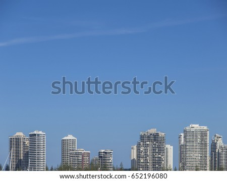 A line of the tops of skyscrapers seen from a Gold Coast beach in Queensland, Australia
