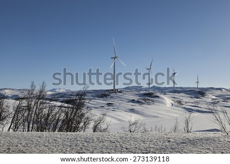 A line of wind turbines  - stock photo