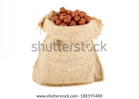 A linen sack from natural raw material the filbert filled by nuts