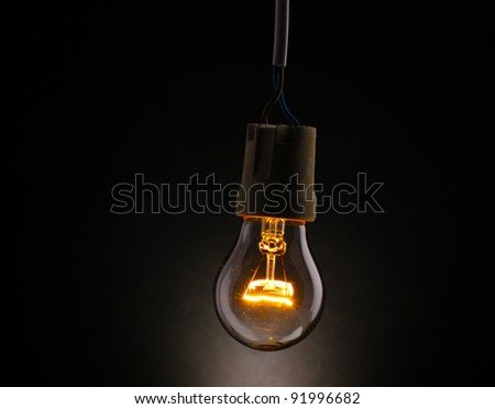 A lit light on black background