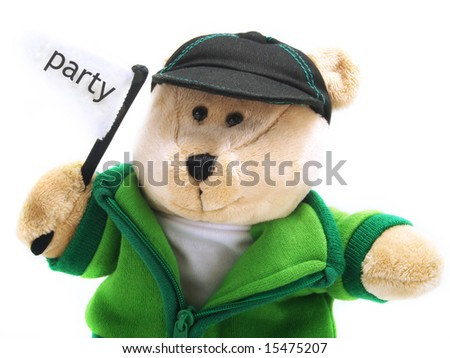 A little adorable teddy bear is sitting and he is holding a flag with party label. He is wearing a green jacket, brown pants, a hat and he's isolated on white background. - stock photo