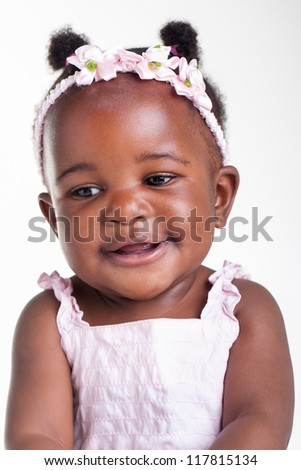 A little African baby with a cute smile. - stock photo