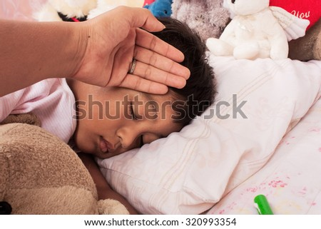 a little asian boy sick mother take care