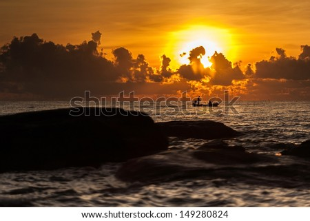 A little boat  in sunset on the sea  - stock photo