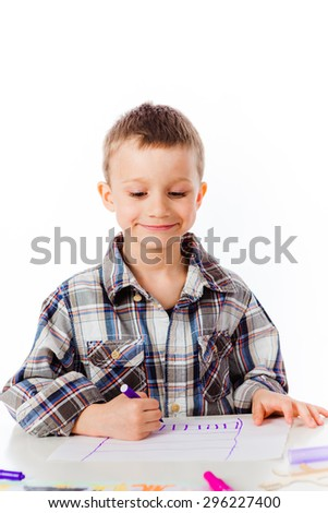 A little boy drawing a picture with a marker - stock photo
