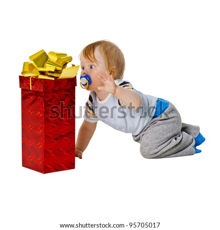 A little boy gets a big gift in red box isolated on white background - stock photo
