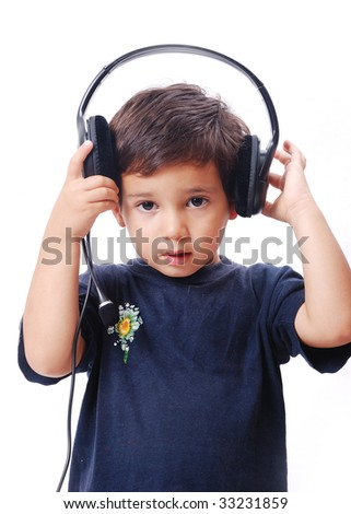 A little boy holding headphones on his head