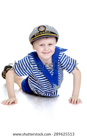 A little boy in a sailor suit - isolated on white background
