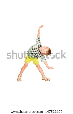 A little boy in a striped T-shirt dancing. Cheery party. Isolated on white background. - stock photo