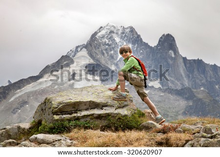 A little boy is climbing on mountain