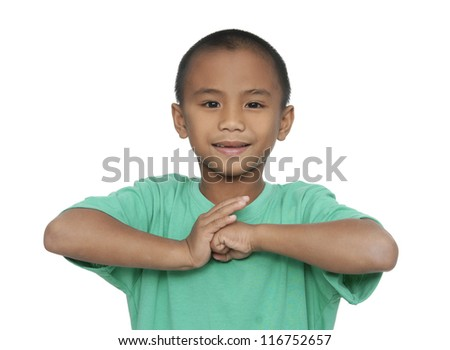 A little boy keeping silence by covering his mouth by hand