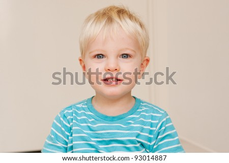 A little boy looking at the camera. - stock photo