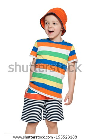 A little boy looks away with delight - stock photo