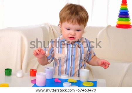 A little boy plays with enthusiasm. Symbol of the family. - stock photo