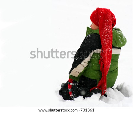 a little boy sitting in the snow