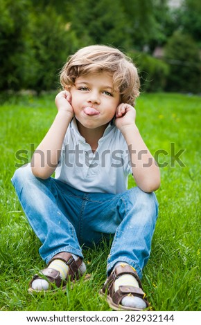 a little boy sticking out his tongue - stock photo