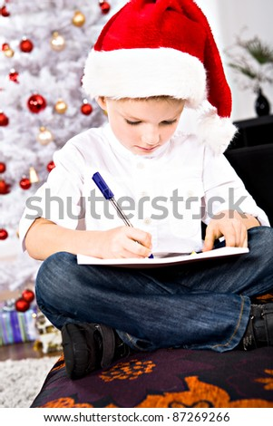 a little boy writing a letter to Santa