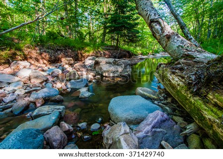 A little brook trout stream tumbles over boulders - stock photo
