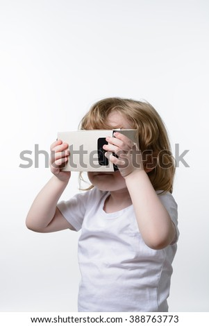 A little child playing a virtual reality glasses