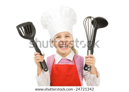 a little cook with kitchen utensils - stock photo