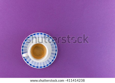 a little cup of espresso coffee on colored background - stock photo
