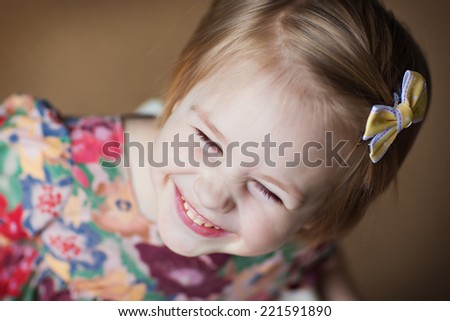 A little cute smiling girl close up.  - stock photo