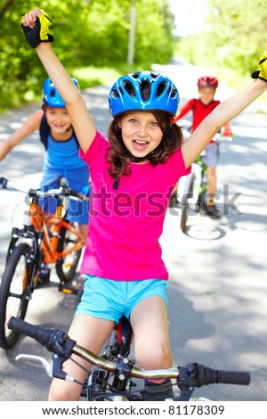 A little cyclist enjoying her victory - stock photo