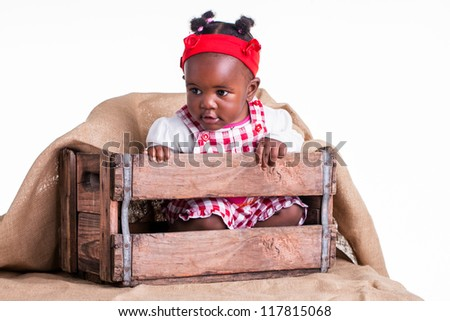 A little girl are safe in a box. - stock photo
