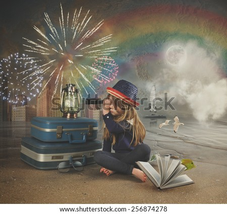A little girl at the beach is looking through a magnifying telescope at fireworks in the sky with a map and rainbow in the background for a travel imagination concept. - stock photo