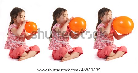 a little girl blowing up a balloon, isolated - stock photo