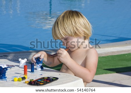 A little girl draws near the pool