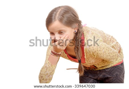 a little girl  has a stomachache, isolated on white background - stock photo