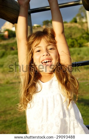 A little girl having a great time in an outdoor park.