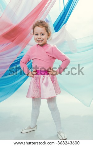 A little girl in a beautiful skirt - stock photo