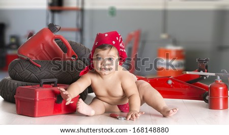 a little girl in a mechanical workshop