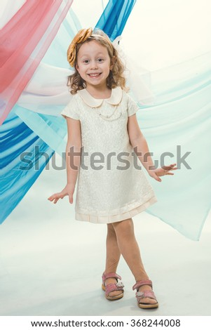 A little girl in a white dress - stock photo