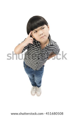 A Little girl in casual clothes looking up and thinking isolated on white with Clipping path. - stock photo