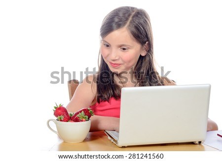 a little girl looking  the strawberries with envy  on white - stock photo