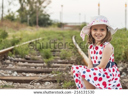 A little girl on railroad - stock photo